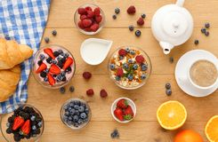 Continental breakfast with croissants and berries on natural wood Royalty Free Stock Photo