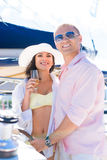 Rich couple have a party on a luxury sailing boat at summer Stock Images