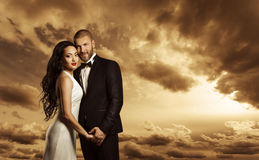 Rich Couple Portrait, Elegant Woman Dress and Man Suit Fashion royalty free stock image