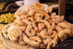 Rich crispy and crispy pork rinds. Rich fried and crunchy pork rinds sold in a market stall Royalty Free Stock Photo