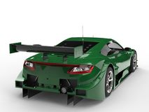 Rich dark green modern sports car concept - tail lights view Stock Photography