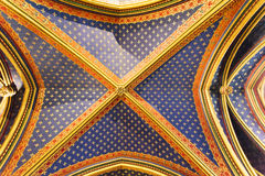 Rich decorated ceiling inside the Sainte Chapelle a royal Medieval chapel in Paris, France. Europe Royalty Free Stock Photography