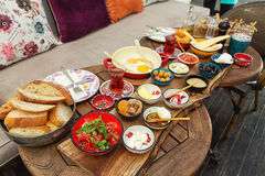 Rich and delicious Turkish breakfast on a round table Stock Photography