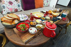 Rich and delicious Turkish breakfast on a round table Stock Images
