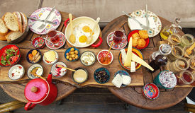 Rich and delicious Turkish breakfast on a round table. Rich and delicious raditional Turkish breakfast on a laid table royalty free stock images