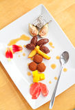 Rich dessert with chocolate and fruits Stock Images