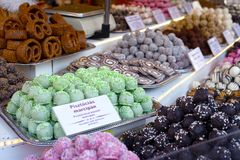 Sweets, cookies and cakes for sale on a Christmas Market in Budapest, Hungary. Rich display full of colorful sweets, cakes, candies, for sales on a Christmas royalty free stock photos