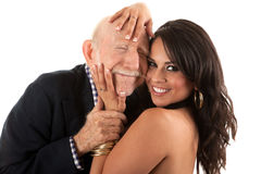 Rich elderly man with gold-digger wife royalty free stock photography