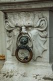 Rich and elegant marble frown adorning a historic building at City Center of Bruges. stock images