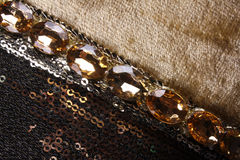 Rich Fabric Art. A beautiful pattern of sequins and gemstones on a classic fabric Stock Photo