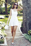 Rich fashionable woman walking in park Royalty Free Stock Photo