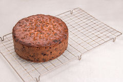 Rich fruit cake/Simnel cake Traditional British Easter cake, baked on a wire cooling tray Stock Images