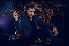 Rich gambler man. With the cards and chips in casino. Gambling, playing cards and roulette stock images