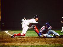 Rich Gedman Boston Red Sox. Former Boston Red Sox catcher Rich Gedman tags out Gary Carter in the 1986 World Series Stock Photo