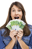Rich girl. Beauitful woman holding some Euro currency notes, isolated over white background Stock Photo