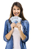 Rich girl. Beauitful woman holding some Euro currency notes, isolated over white background Stock Photography