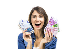 Rich girl. Beauitful woman holding some Euro currency notes, isolated over white background Royalty Free Stock Photo