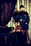 Rich girl. Gorgeous fashion model in a rich historical costume. Fur clothing. Vintage. Luxury style Royalty Free Stock Image