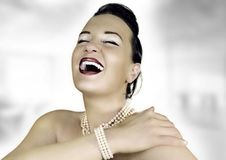 Rich girl laughing. Rich girl with perls an red lips laughing Royalty Free Stock Photos