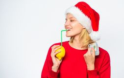Rich girl with lemon and money. Woman lemon millionaire. Lemon money concept. Symbol of wealth and prosperity. Girl. Santa hat drink juice lemon straw while stock photos