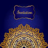 Rich gold invitation card in the Indian style. Stock Images