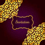 Rich gold invitation card in the Indian style. Royalty Free Stock Image