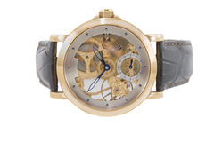 Rich gold swiss made chronograph Royalty Free Stock Photos