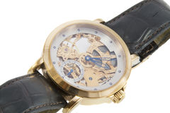 Rich gold swiss made chronograph watch. In white background Royalty Free Stock Images