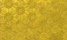 Rich golden floral pattern. rough golden texture for creative designs. Rich golden floral rough textured background. Golden Grunge floral pattern with gold Stock Images