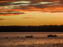 Rich Golden Sunset With Boats Royalty Free Stock Photos
