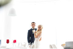 Rich groom and bride huggingoutdoor background wall grass warm a Stock Images