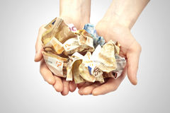 Rich hands full with money Stock Images