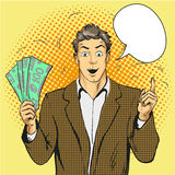 Rich handsome guy hold money and point his finger up. Business concept vector in pop art style. Royalty Free Stock Photo