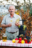 Rich harvest. Kind elderly man smiling to the camera, happy for this year's rich crops stock photography