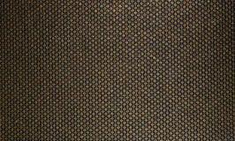 Rich, honungtextur för tyg och tapet Guld fodrar modeller med diamanter på en svart bakgrund Arkivfoto