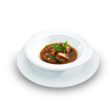 Rich hot hungarian beef goulash with traditional topping Stock Photography
