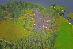 Rich house airplane photo. In Baltic lake near Royalty Free Stock Photos