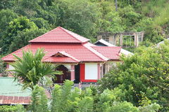 Rich house. With a ruin behind in Sorong (Papua Barat, Indonesia Stock Photos