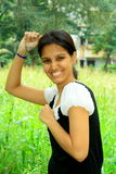Rich Indian girl on her farm. A smart and rich Indian girl on her beautiful green farm Royalty Free Stock Photos