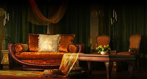 Rich interior. Rich looking sofa and table Royalty Free Stock Image