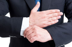 Rich lawyer fixing expensive shirt and suit sleve. Also banker of business man concept stock photo