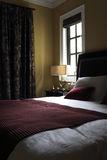 Rich layers of light and shadow in the bedroom Royalty Free Stock Photos