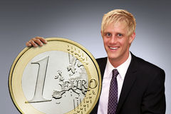 Rich man. Is holding his euro coin royalty free stock photos