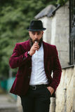 Rich man with a beard smokes electronic cigarette Stock Photo