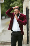 Rich man with a beard smokes electronic cigarette Stock Photography