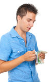 Rich man counts his money Stock Image