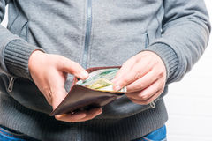 Rich man counts money in a purse, close-up Royalty Free Stock Photography