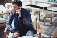 Rich man has telephone call Royalty Free Stock Image