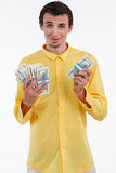 Rich man holding pile of money. Royalty Free Stock Photography