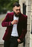 Rich man in a jacket near his house Royalty Free Stock Images